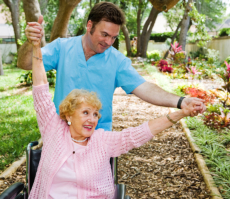 caregiver assisting his elderly